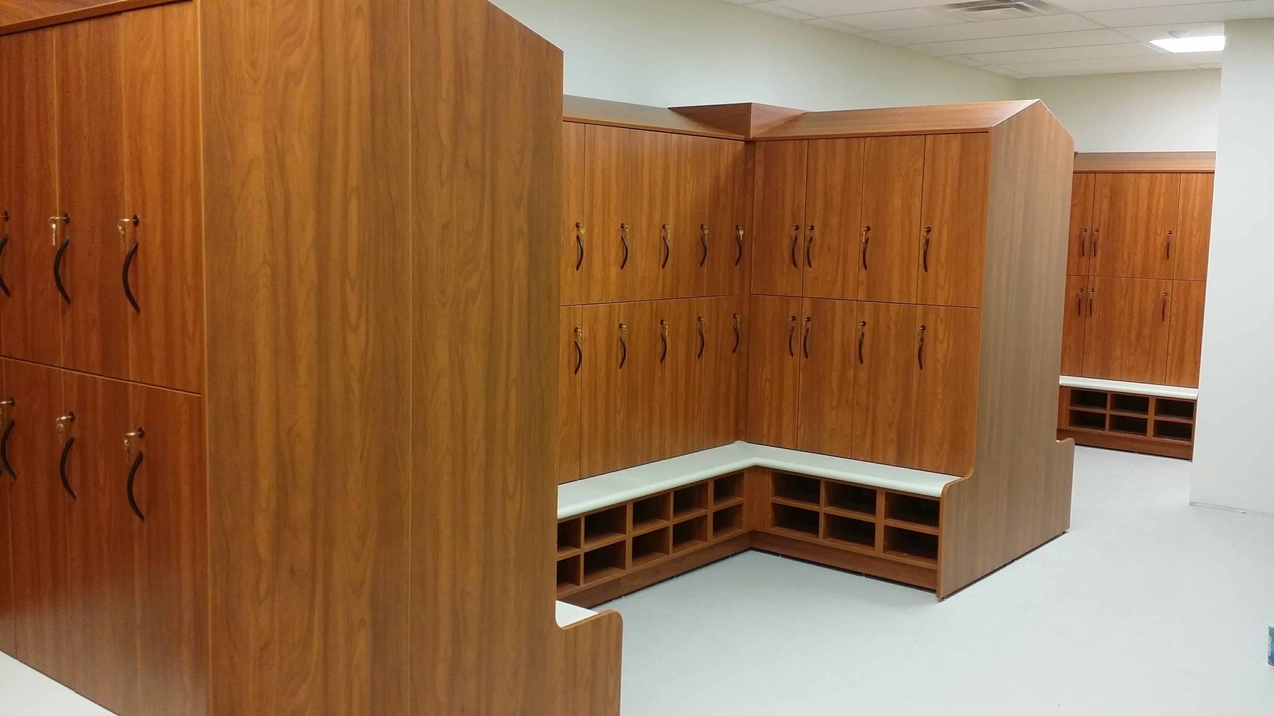 Wood veneer gym lockers with shoe cubbies