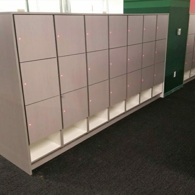 Laminate Temporary-Use Lockers with networked locks and shoe cubbies at the bottom