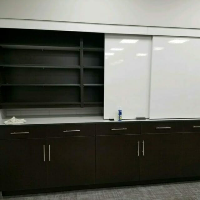 Sliding Whiteboards in front of Casework Storage Wall