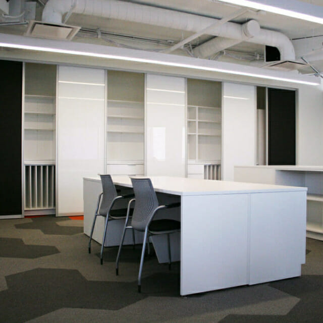 Storage Wall with Sliding Whiteboards for Collaborative Meetings